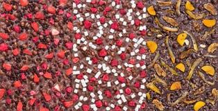 Três tipos de barras de chocolate com bagas, fruto e as porcas secados Imagem de Stock Royalty Free