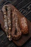 Três tipos de salsicha picante secada Fotografia de Stock
