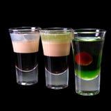 Três tiros mergulhados cocktail isolados Fotos de Stock