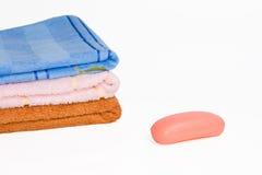 Três toalhas e sabões Fotografia de Stock Royalty Free