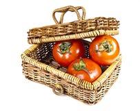 Três tomates na cesta com tampa Fotografia de Stock