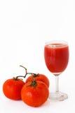 Três tomates vermelhos Fotografia de Stock