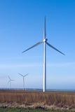 Três turbinas de vento, céu azul. Imagem de Stock Royalty Free