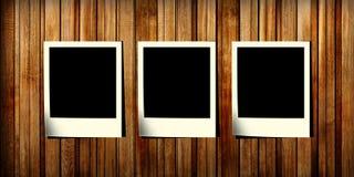 Três uma corrediça da foto em uma madeira Foto de Stock