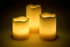 Três velas amarelas do diodo emissor de luz Imagens de Stock Royalty Free