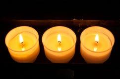 Três velas da oração Foto de Stock Royalty Free