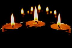 Três velas e suas reflexões Imagem de Stock Royalty Free