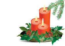 Três velas vermelhas do Natal. Imagens de Stock