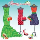 Três vestidos do coctail com acessórios Mola ilustração royalty free