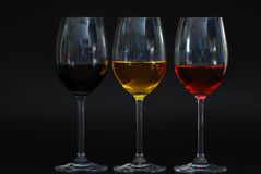 Três vidros com fundo preto Imagens de Stock