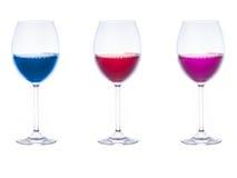 Três vidros com líquidos coloridos para dentro Fotografia de Stock Royalty Free
