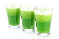 Três vidros com suco do aipo Fotografia de Stock
