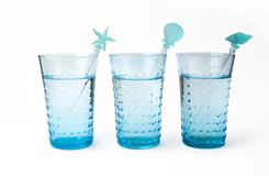 Três vidros da água mineral com palha Fotografia de Stock Royalty Free