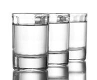 Três vidros da vodca Imagem de Stock Royalty Free