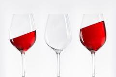 Três vidros de vinho branco vermelhos Imagem de Stock