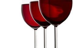 Três vidros de vinho vermelho Fotos de Stock Royalty Free