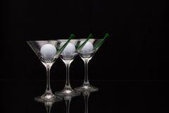 Três vidros do champanhe e das bolas de golfe Imagens de Stock Royalty Free