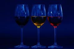 Três vidros no azul Imagens de Stock Royalty Free