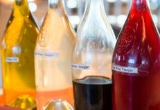 Três vinagres e um óleo Imagens de Stock