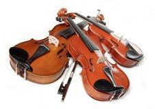 Três violinos Foto de Stock