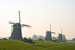 Três watermills após o nascer do sol fotografia de stock