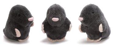 Trío Gentlemans en juguete aislado terciopelo negro Foto de archivo