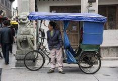 Trójkołowa taksówkarz, Pudong, Szanghaj Obraz Stock