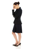 Trött affärskvinna som trycker på hennes huvud Arkivfoto