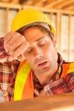trött arbetare för konstruktion Arkivfoton