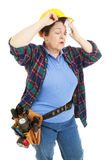 trött arbetare för konstruktionskvinnlig Royaltyfria Bilder
