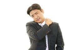 Trött asiatisk affärsman Royaltyfri Bild