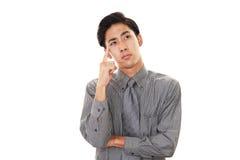 Trött asiatisk affärsman arkivfoton