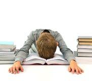 Trött och uttråkad pojke med böcker Arkivbild