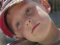 Trött pojkerodd på floden Fotografering för Bildbyråer