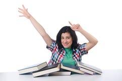 Trött student med läroböcker Arkivbild