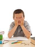 tröttad schoolboy Royaltyfri Bild