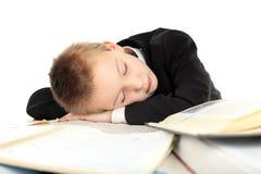 tröttad schoolboy arkivbilder