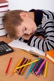 tröttad schoolboy Arkivfoto