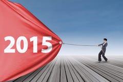 Tração asiática número 2015 do trabalhador Imagens de Stock