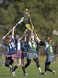 Tração do Lacrosse das meninas Fotos de Stock Royalty Free