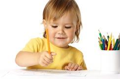 Tração feliz da criança com pastéis e sorriso fotos de stock royalty free