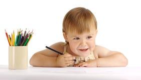 Tração feliz da criança com pastel azul Imagem de Stock Royalty Free