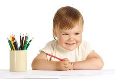Tração feliz da criança com pastel vermelho Imagens de Stock Royalty Free