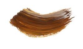 Traçage abstrait de peinture brune sur le blanc photos stock