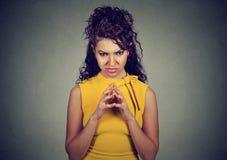 Traço manhoso, planejando da jovem mulher algo Imagem de Stock Royalty Free