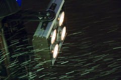 Traços de flocos de neve no projetor Imagens de Stock