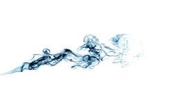 Traînée bleue de fumée d'isolement sur le blanc Photographie stock libre de droits