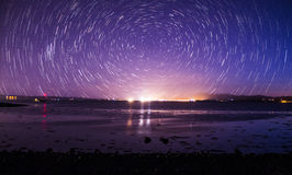 Traînée d'étoile au-dessus de plage Image libre de droits