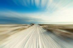 Traînée de plage avec la tache floue de mouvement Photo stock