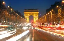 Traînées d'Arc de Triomphe et de lumière, Paris Images stock
